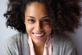 A Woman Smiles | Gum Disease Treatment Hershey PA