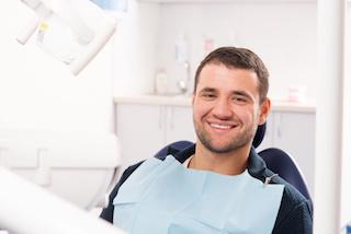 A man smiles in the dental chair | Hershey PA Dental Extractions