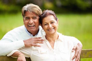 An elderly couple smiles | Hershey PA Dentures