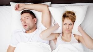 A woman covers her ears because of her husband's snoring | Sleep Apnea Hershey