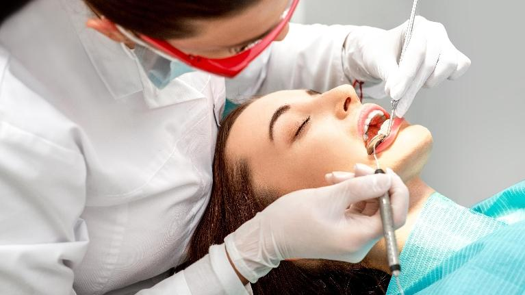 A dentist works on a woman's mouth | Hershey PA dentist