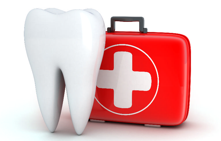 A tooth next to a first aid kit | Dentist in Hershey PA